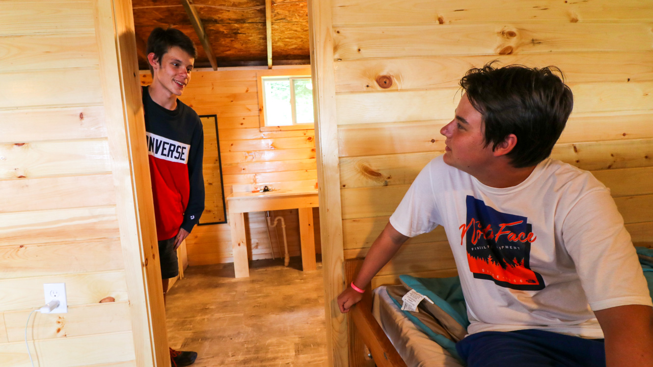 Boys hang out in camp cabin