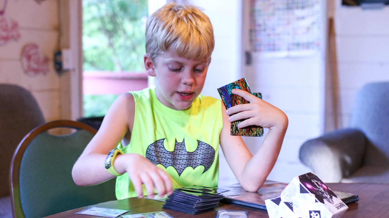 Camper sorts Magic: The Gathering cards
