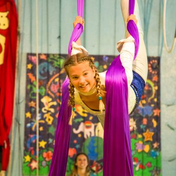 Circus camper performs on aerial silks