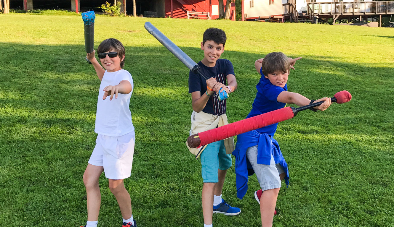 LARPing campers post with foam swords