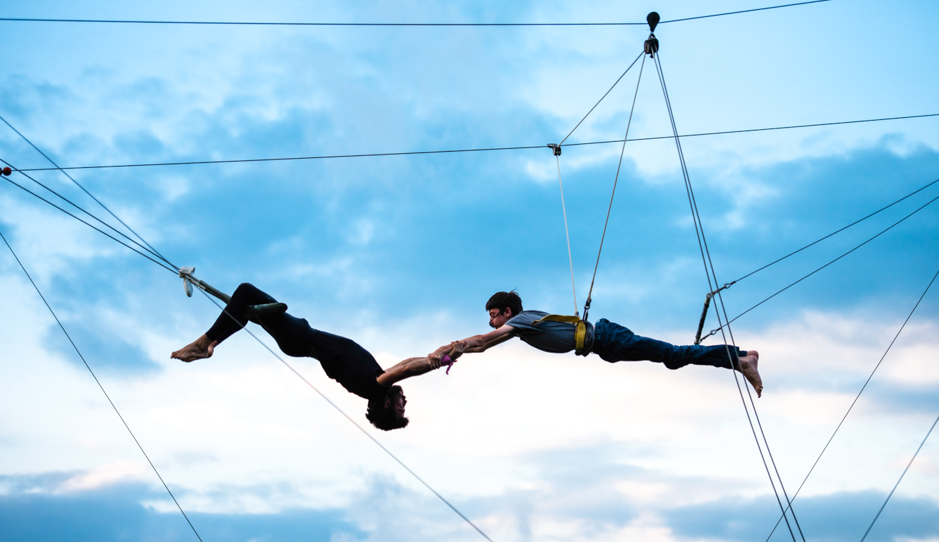 Campers perform on outdoor trapeze
