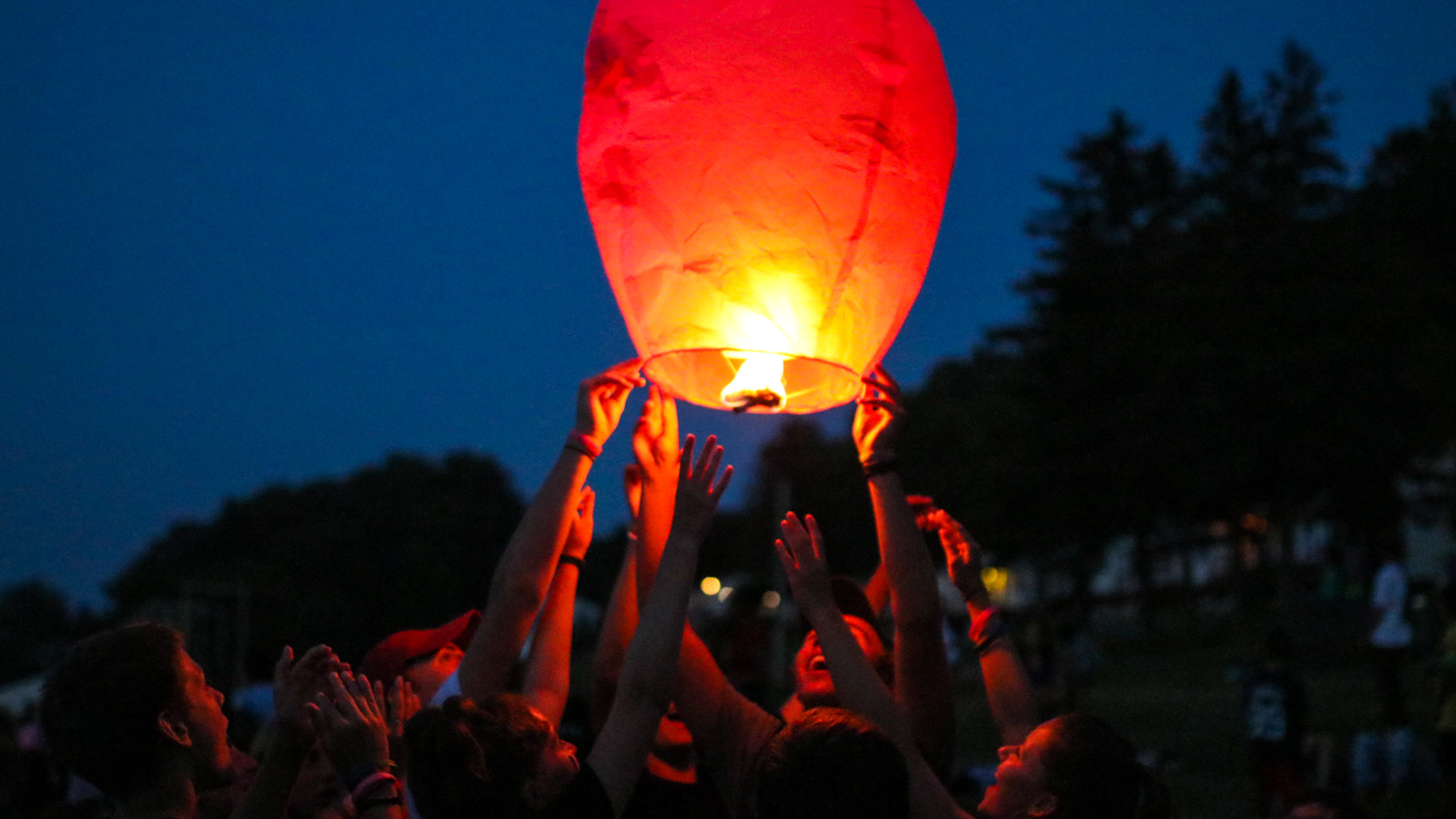 Campers release floating lantern