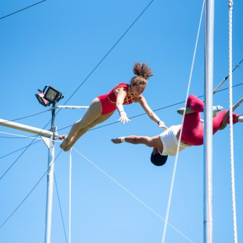 Two campers perform trapeze